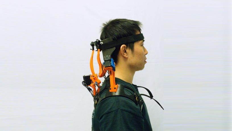 The robotic neck brace worn by a human subject